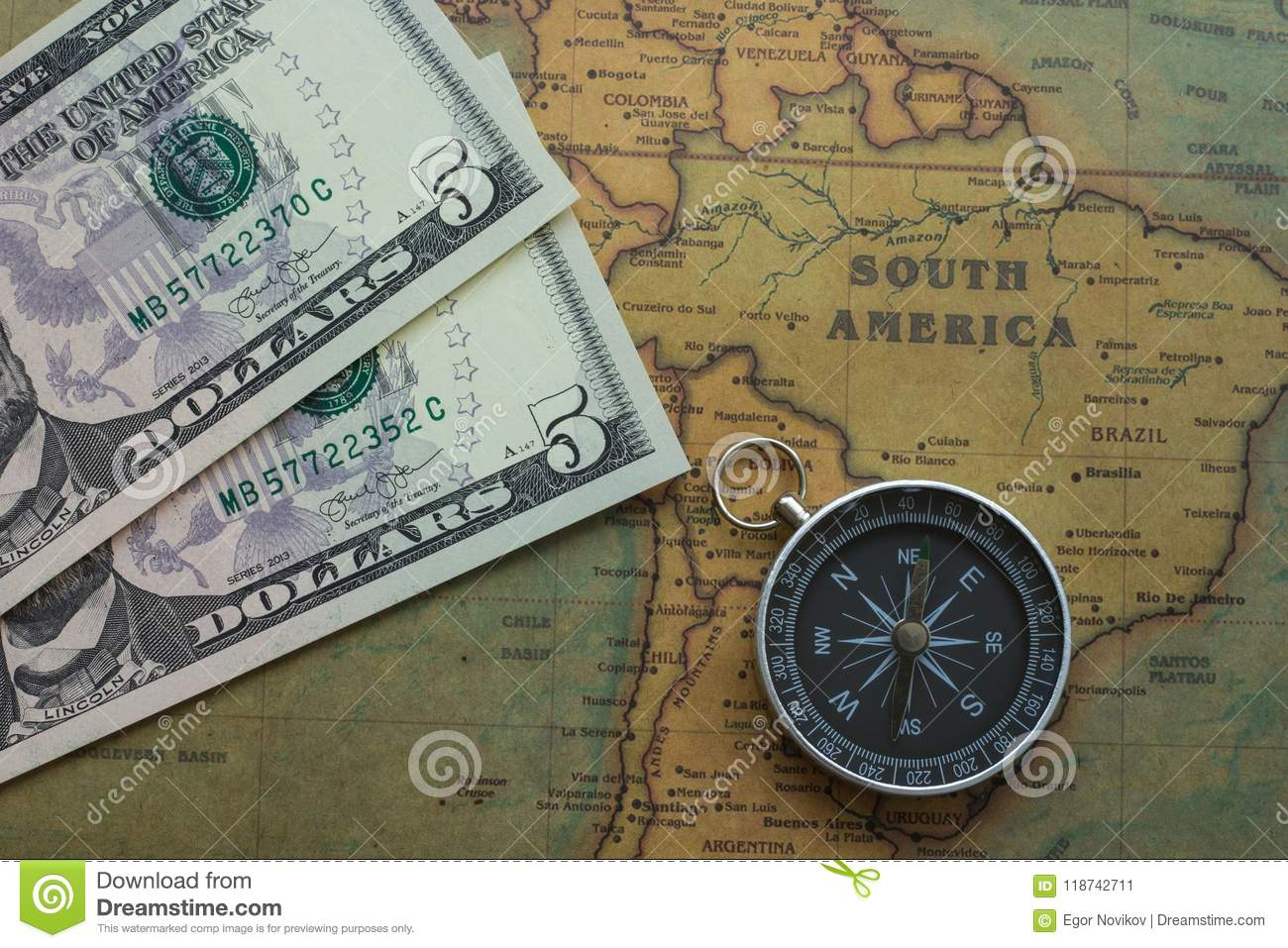 Ancient Map Of South America With Usa Money And A Compass Close Up