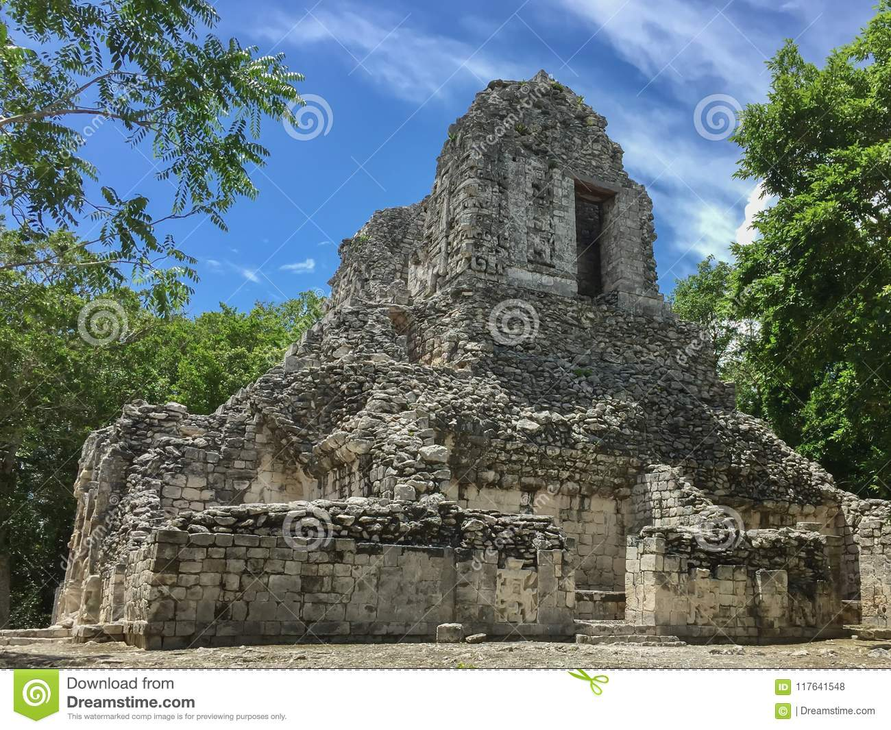 Ancient Maya ruin in Xpujil, Campeche, Mexico sitting in the middle of the jungle