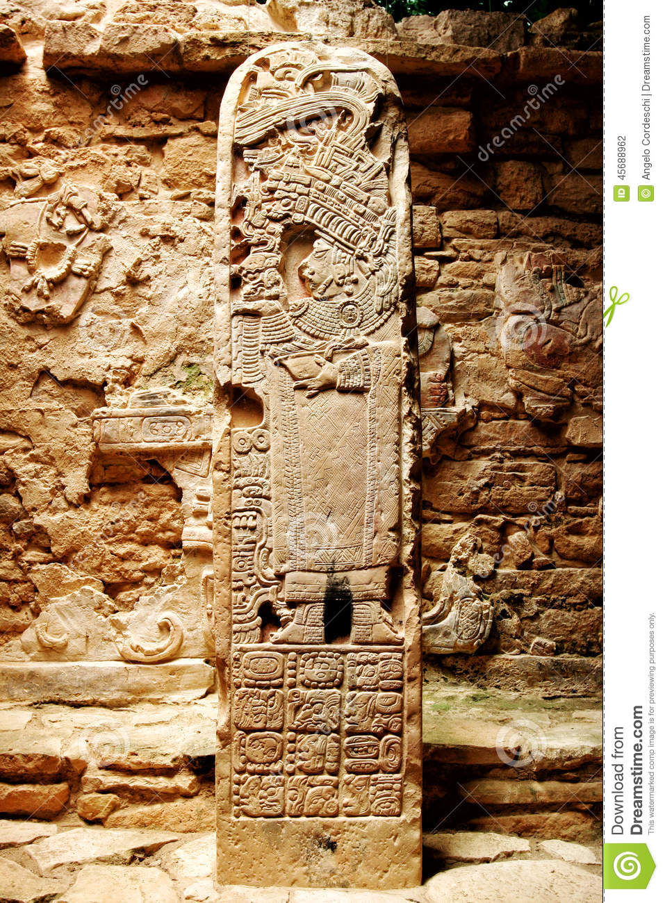 Ancient mexican column stone totem with carvings of the
