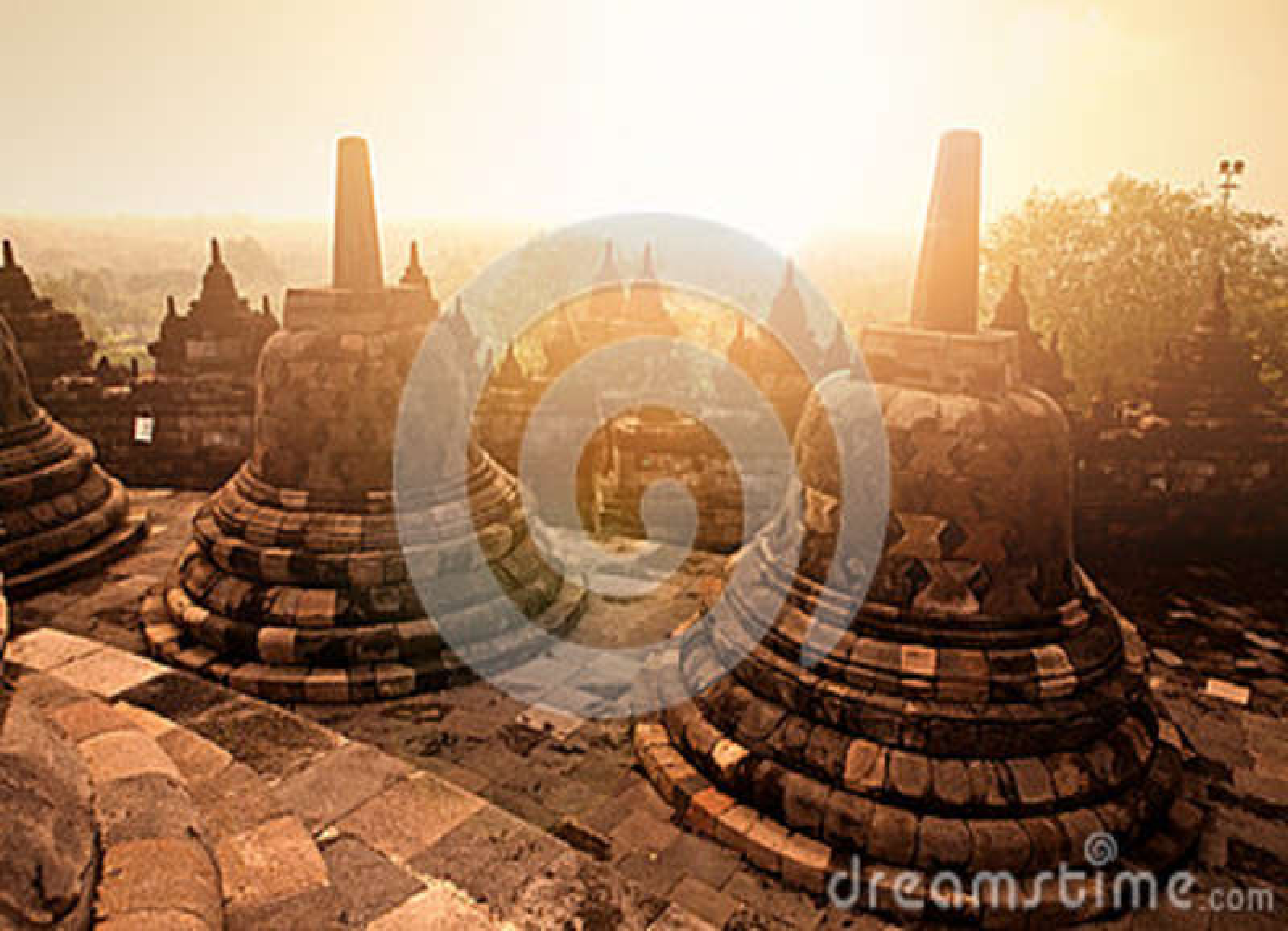 Ancient monument of Borobudur Buddhist temple at sunrise, Yogyakarta, Java Indonesia.