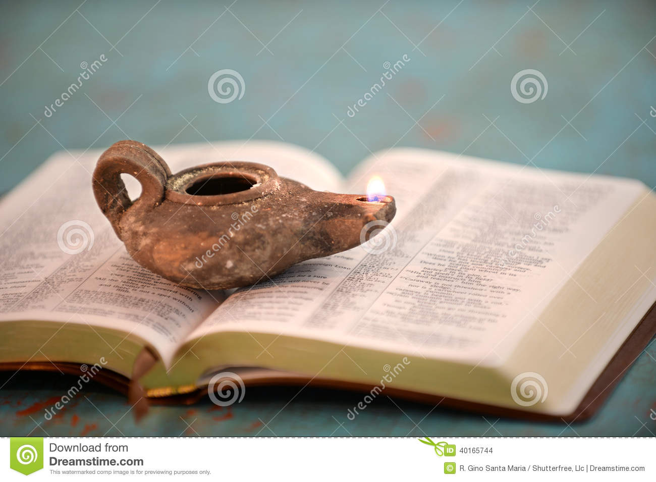Ancient Oil Lamp On Open Bible Stock Photo Image Of
