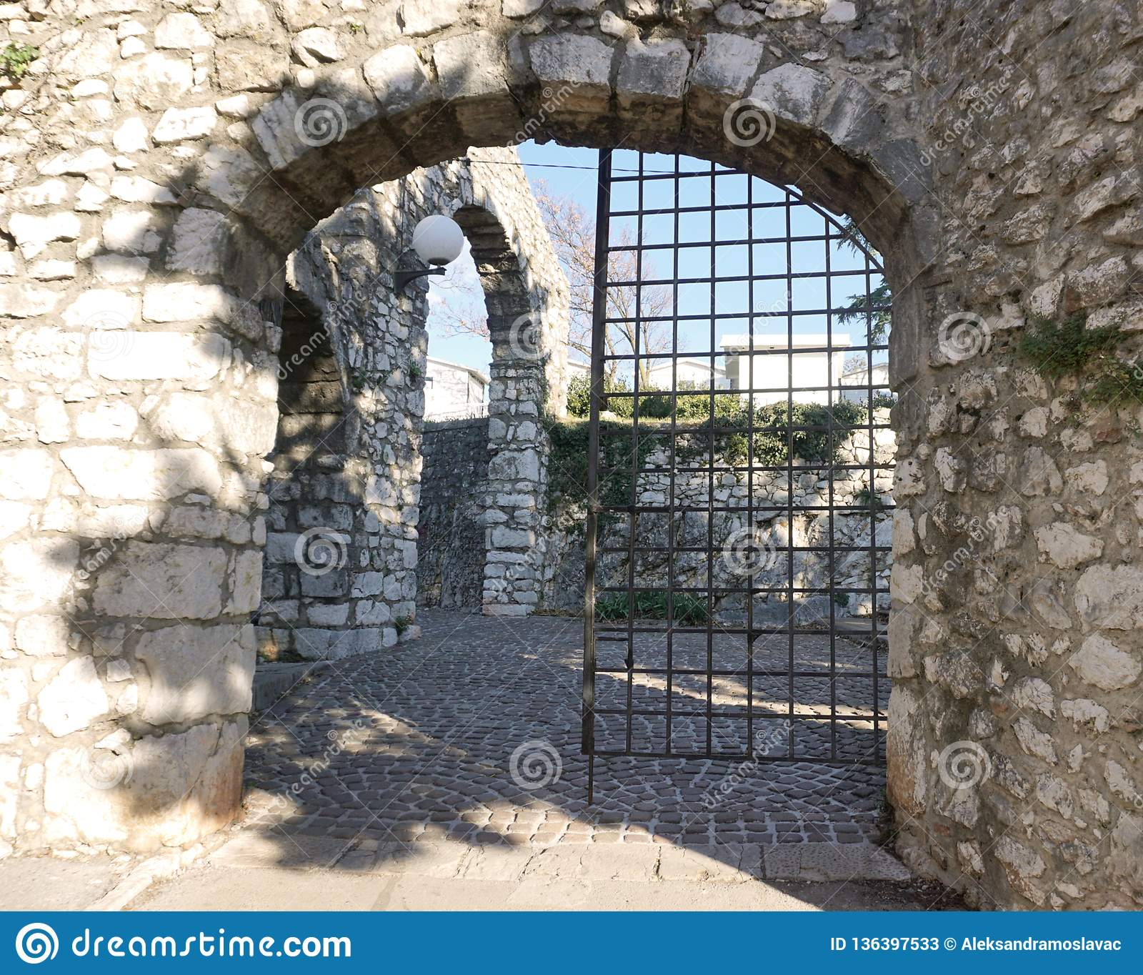 Ancient old castle stone doorway with iron gate