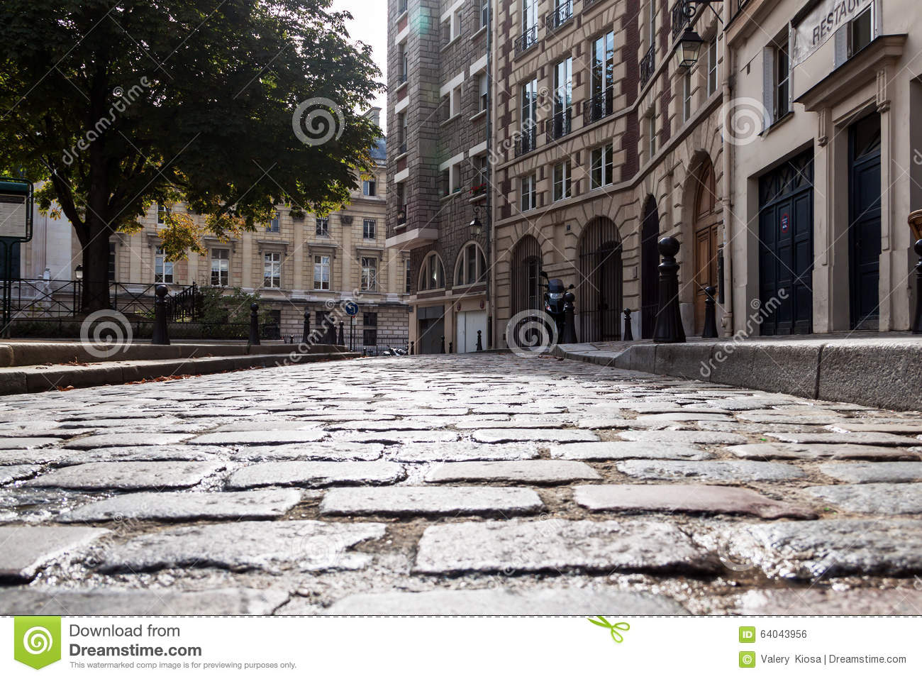 Stone Pavement In Paris : Ancient paving stone on the historic square stock photo