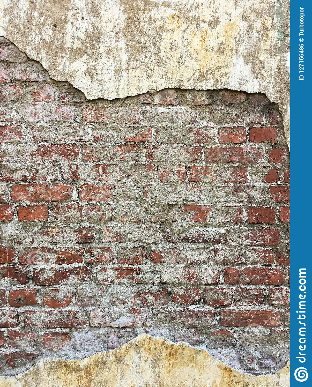 Ancient red brick wall covered with shabby plaster texture copyspace background front view