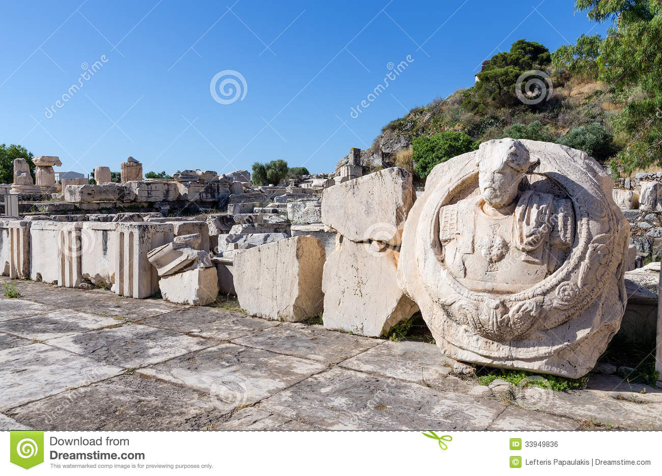 Ancient ruins of Eleusis, bust of Roman Emperor Marcus Aurelius in foreground, Attica, Greece