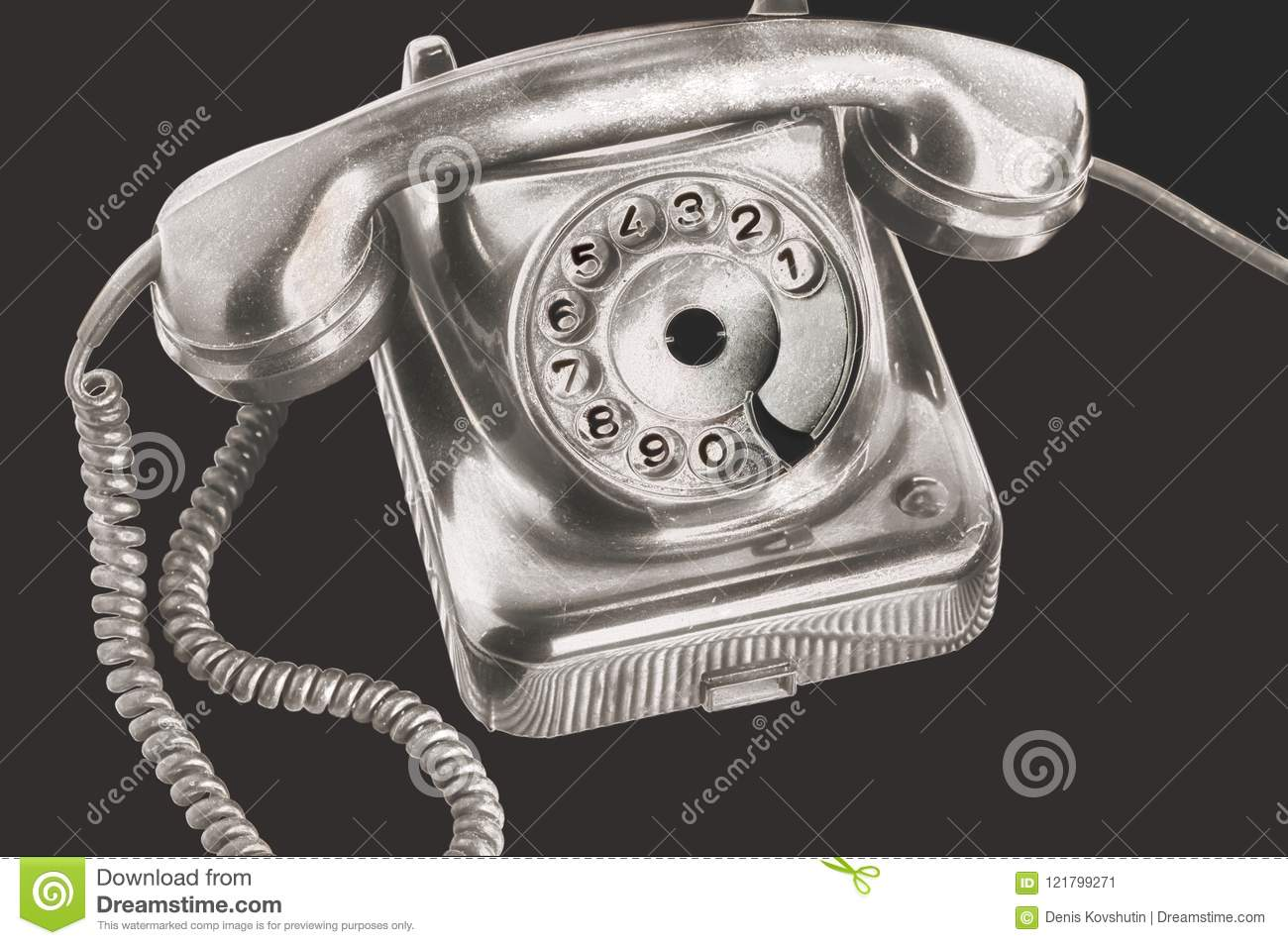 An ancient silver dial disk phone in futuristic processing on isolated black background