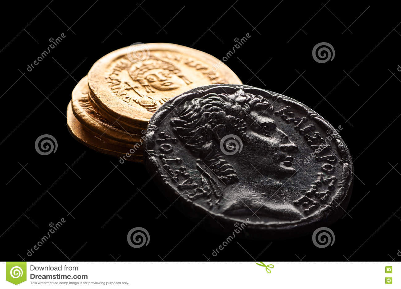 Ancient silver an gold coins isolated on black