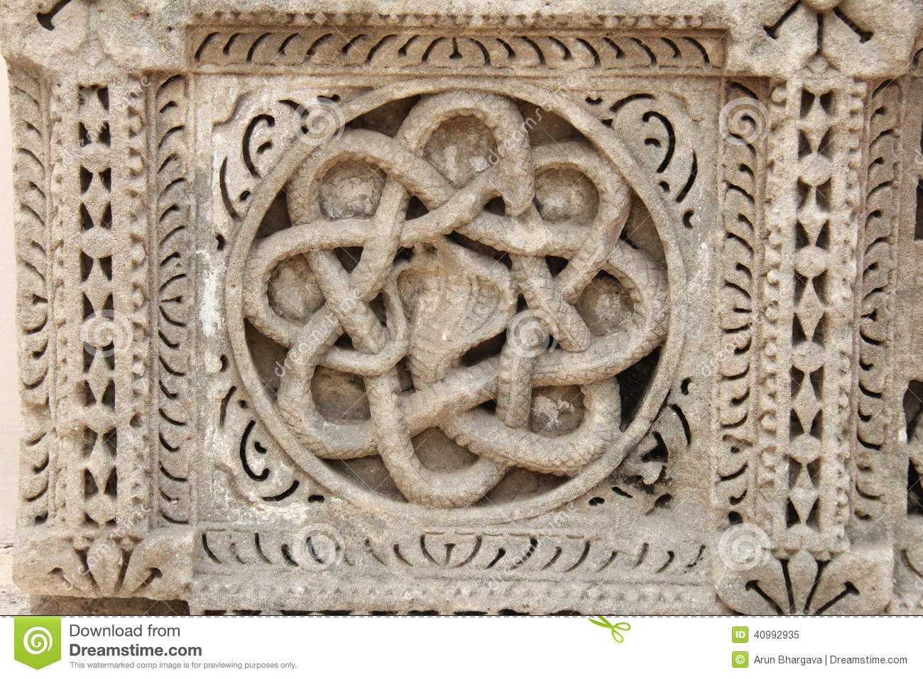 Ancient snake carving on stone stock image of asia