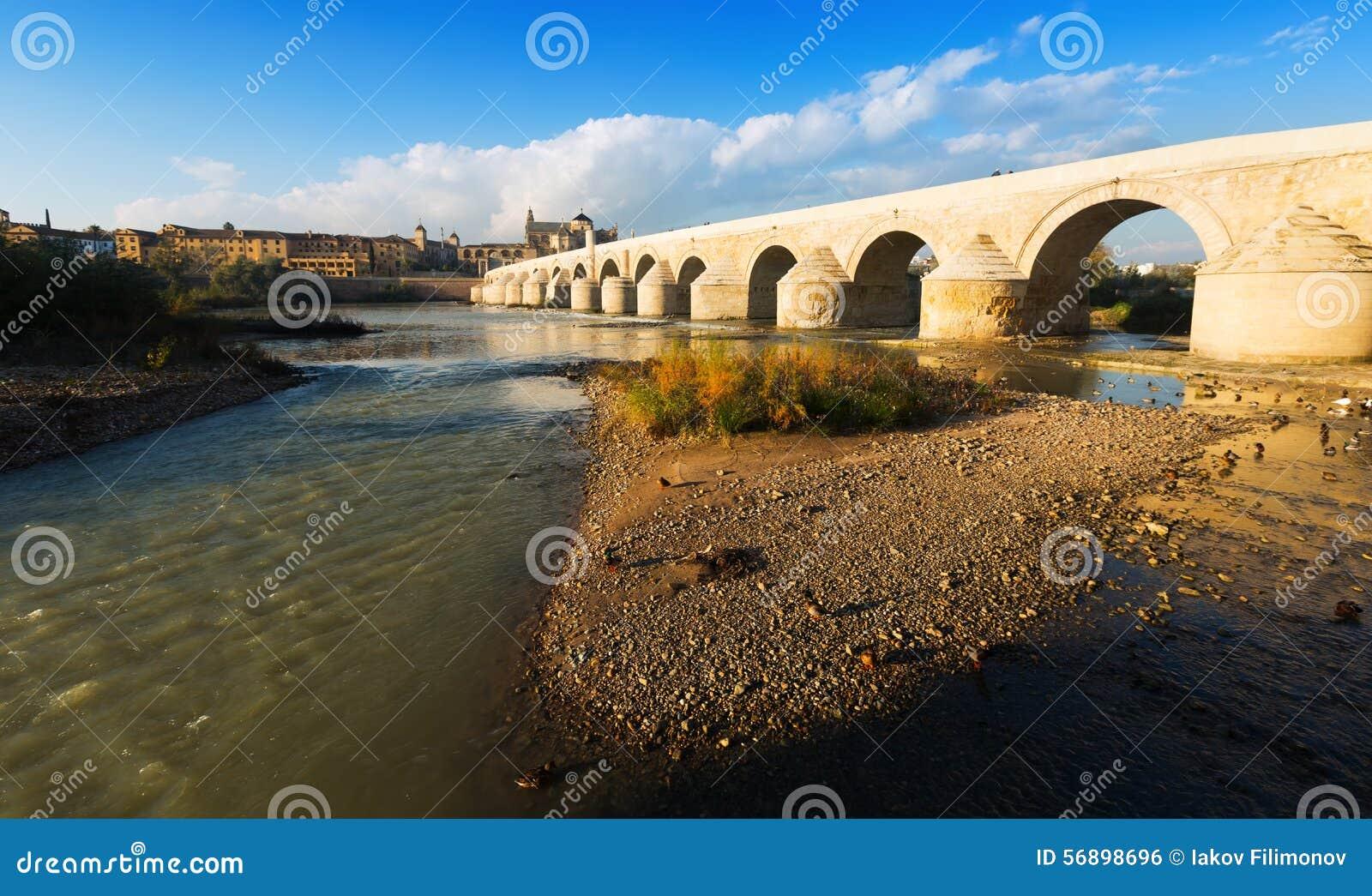Ancient stone bridge over Guadalquivir river in Cordoba