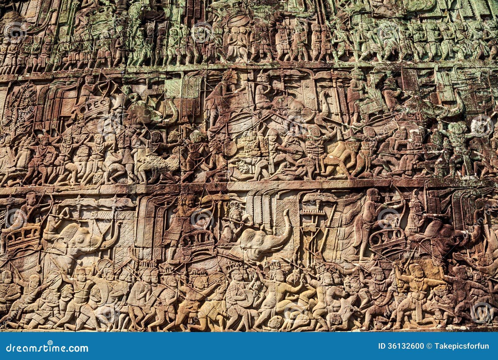 Ancient stone carving on the wall at angkor thom stock