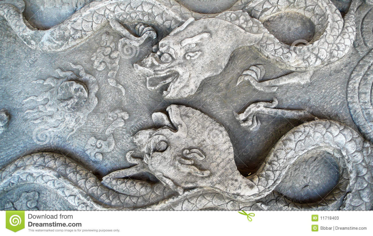 Ancient stone carvings of dragon stock image