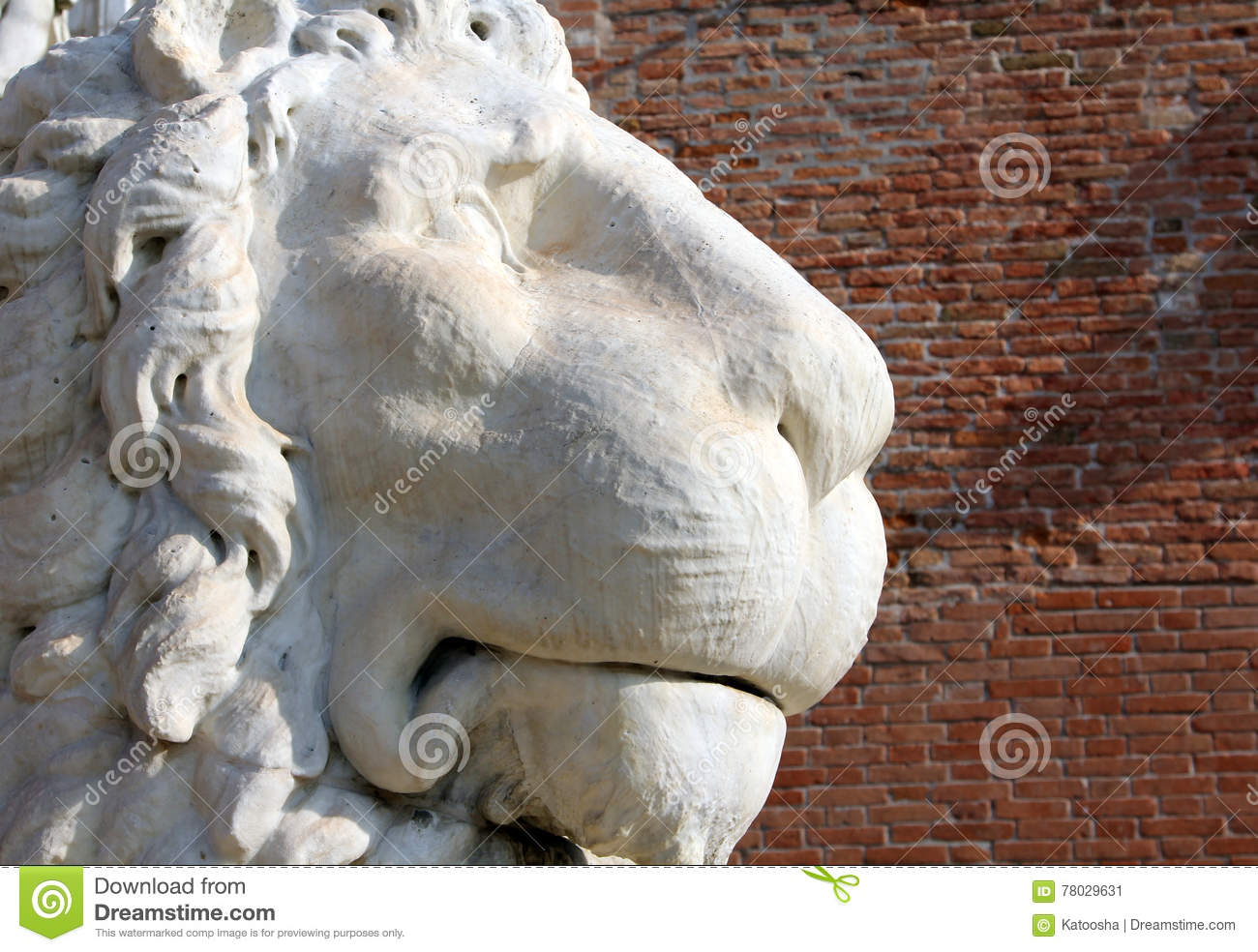 Ancient stone lion statue at the gates of Arsenal, Venice, Italy