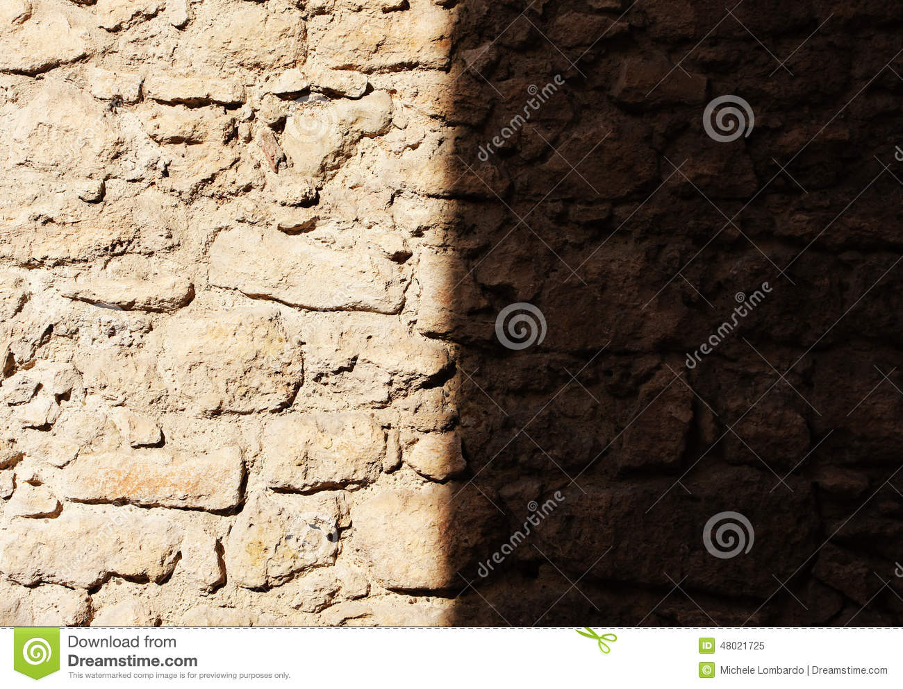 Ancient Stone Wall One Half In The Shadow Stock Photo