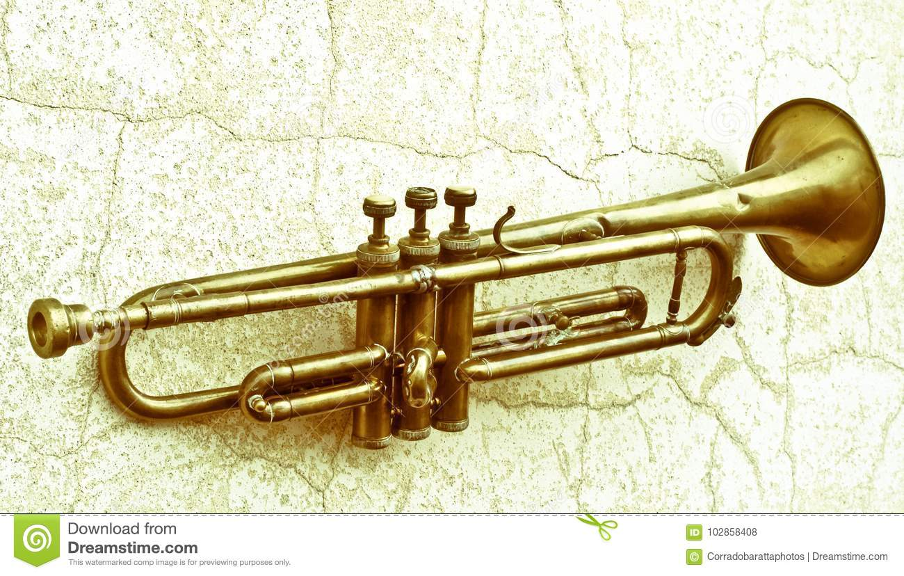 An Ancient Trumpet From The 1920s Is Now Hung On A Wall Stock Photo ...
