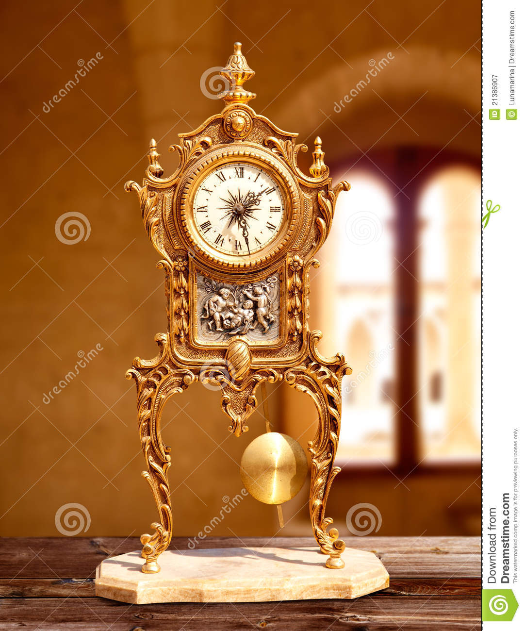 Ancient Vintage Golden Brass Pendulum Clock Stock Image