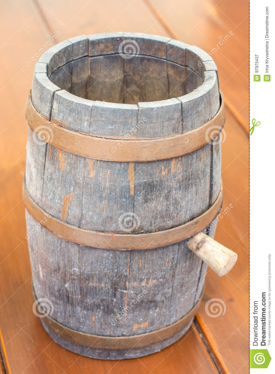 Ancient wooden barrel for beer on the table