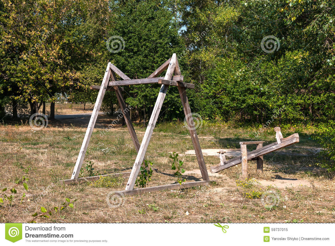 Ancient wooden swing in an old village stock photo image for Swingvillage