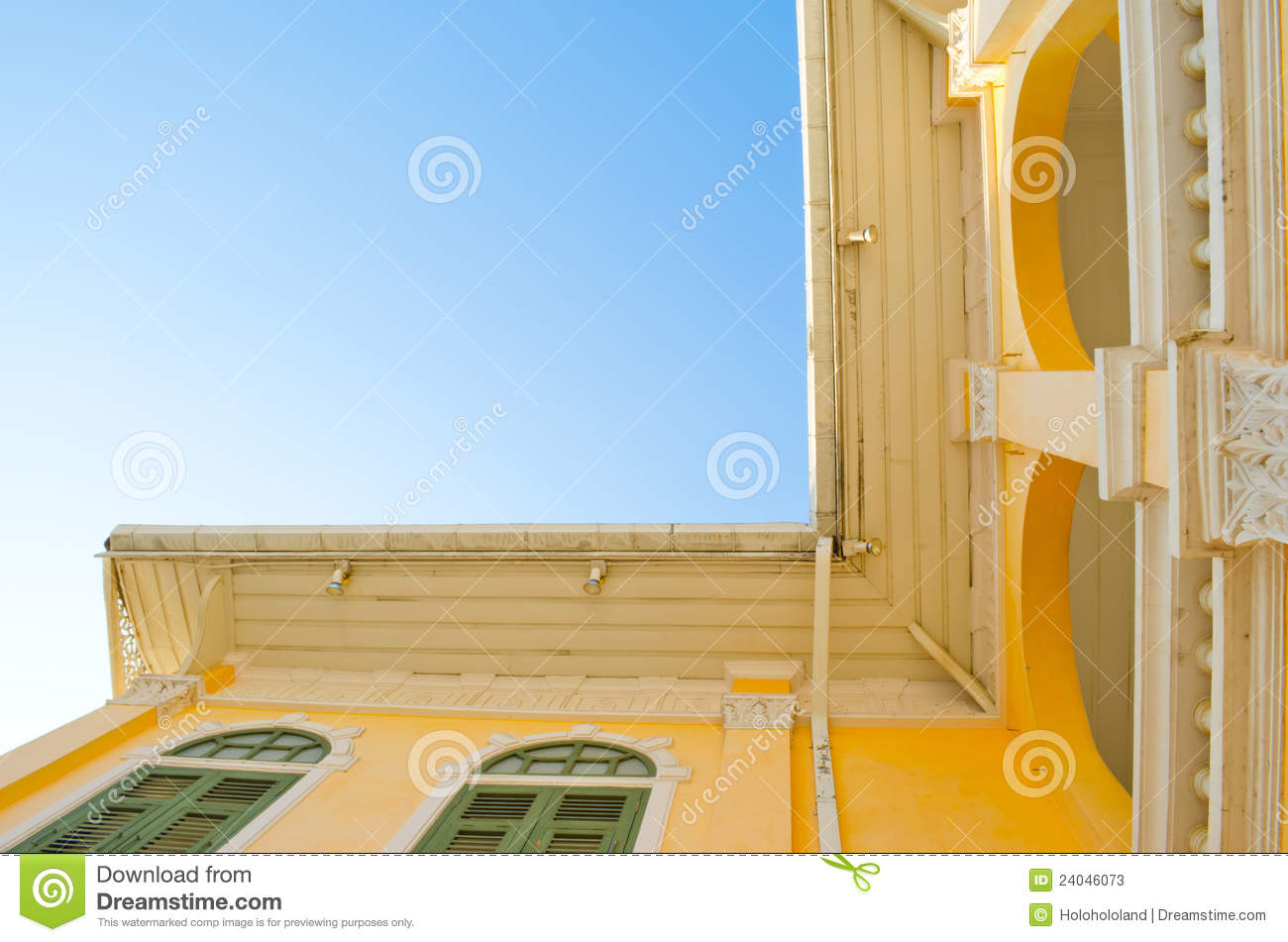 Ancient yellow house outside right angle stock photos for Right angle house
