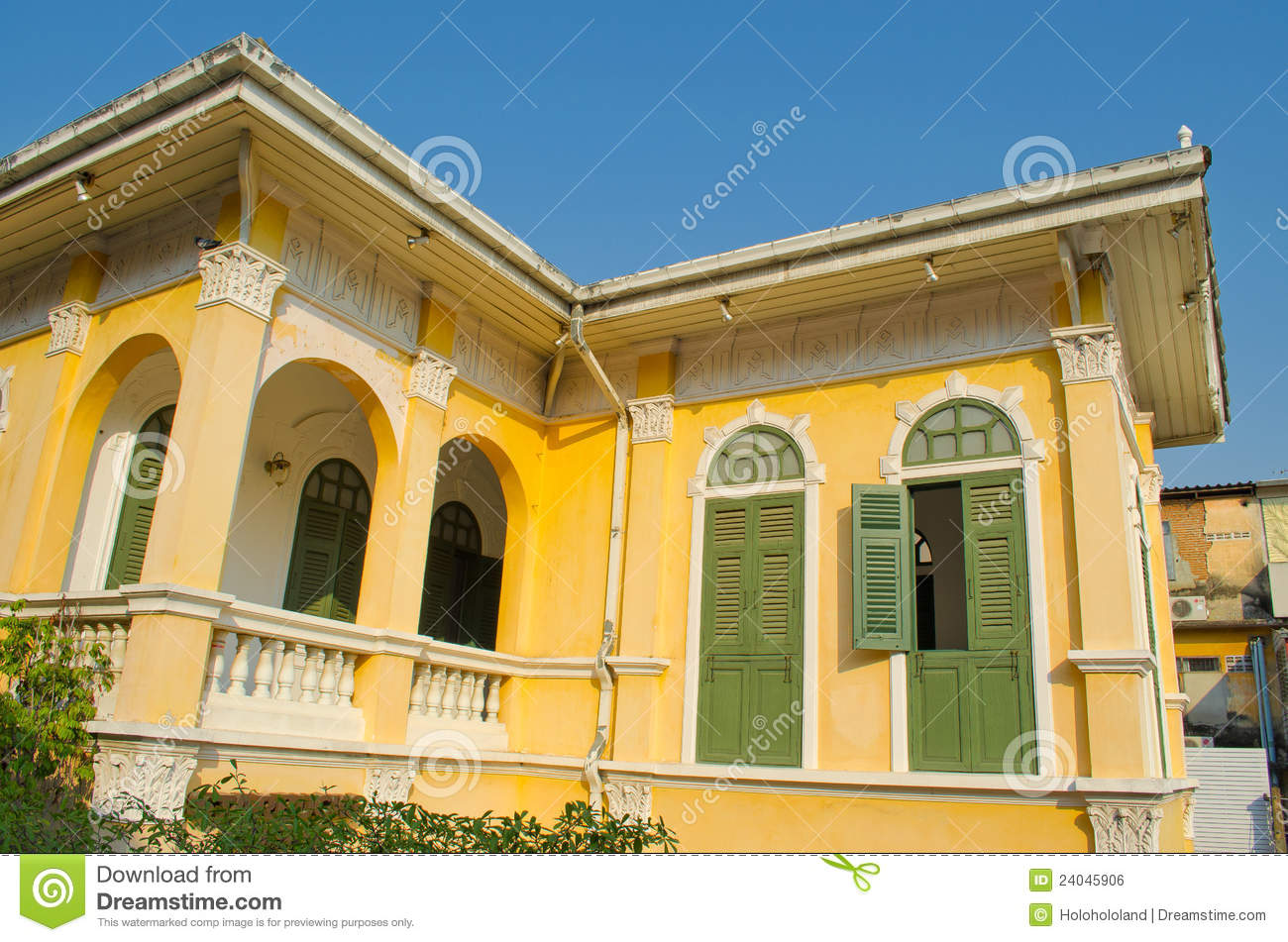 Stock images of ancient yellow house outside second floor view 1