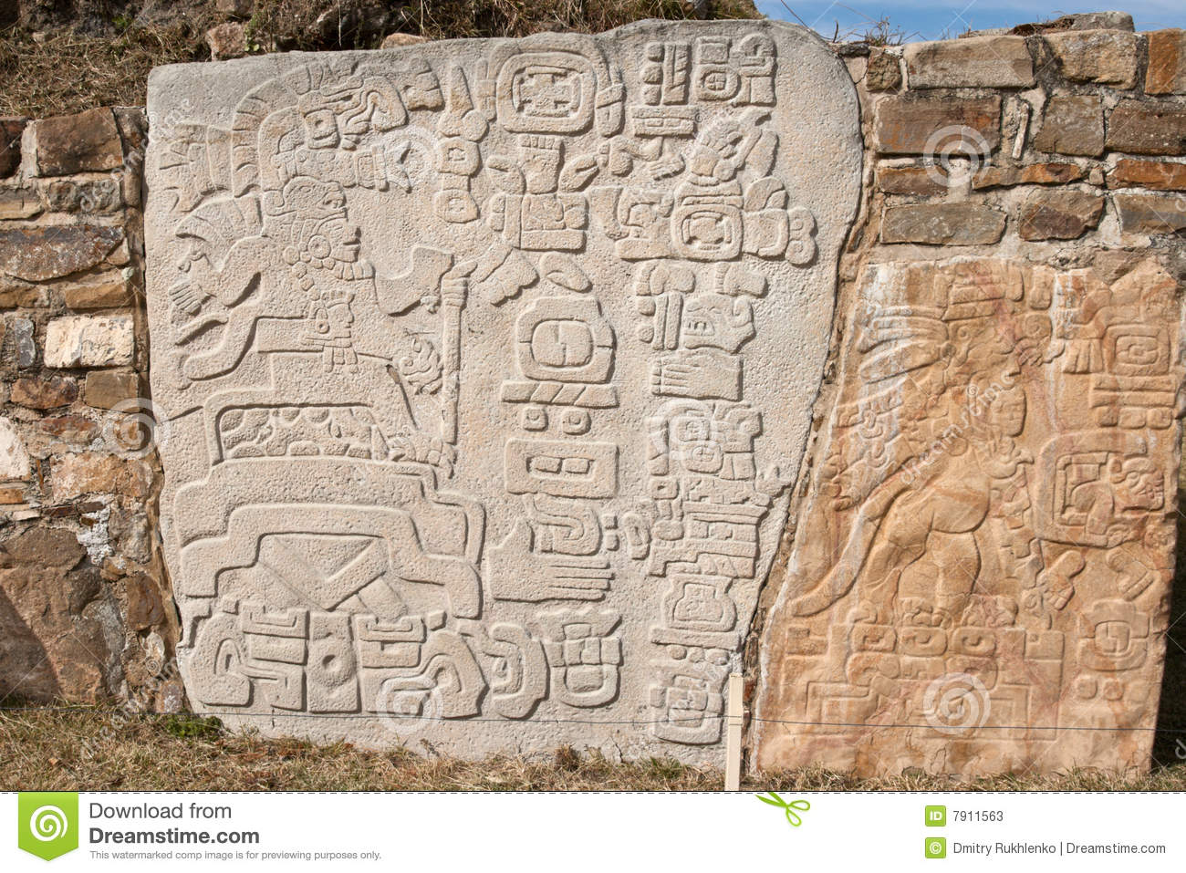 Ancient zapotec relief on the wall stock image of