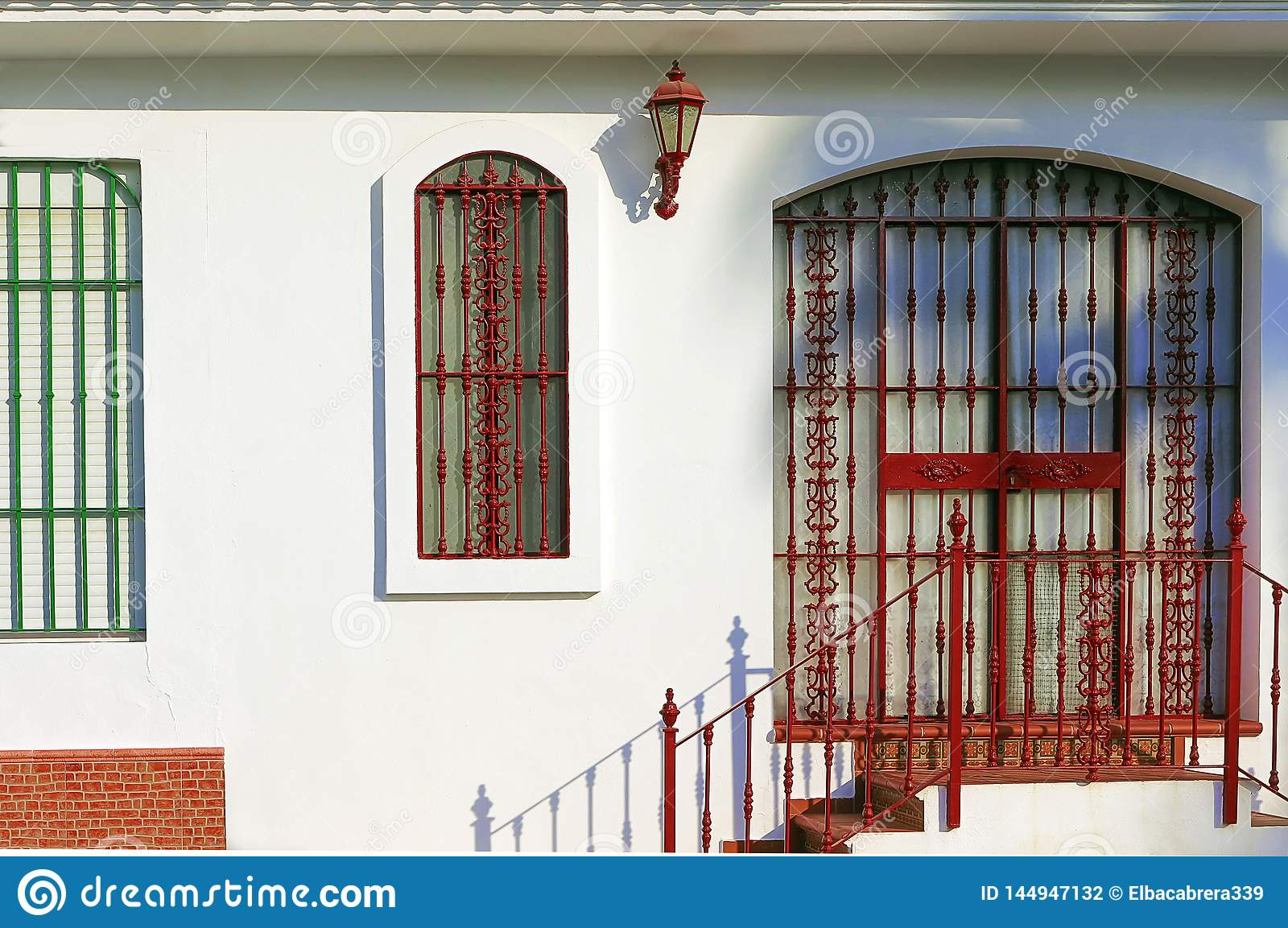 Andalusian House Facade With Wrought Iron Bars On Door And Window Stock Photo Image Of Painted Andalusian 144947132