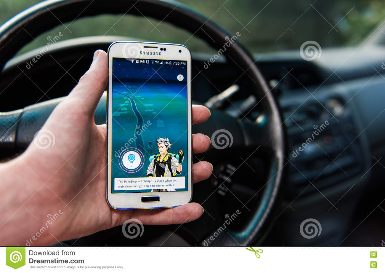 Android User Playing Pokemon Go Editorial Stock Image