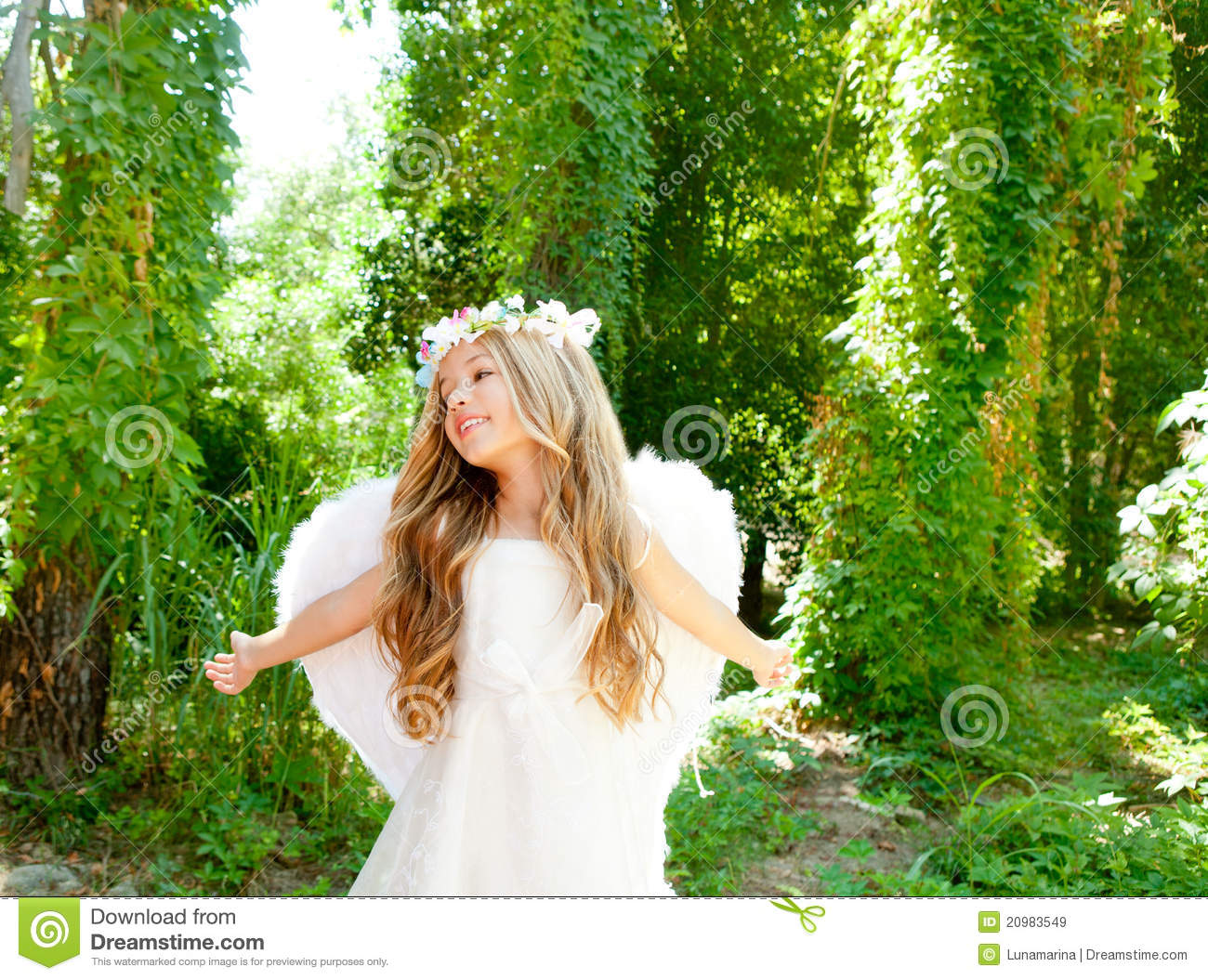 angel children girl open arms in forest stock image