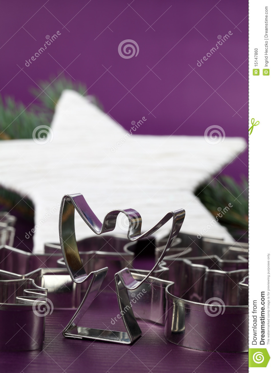 Angel cookie cutter on Christmas background