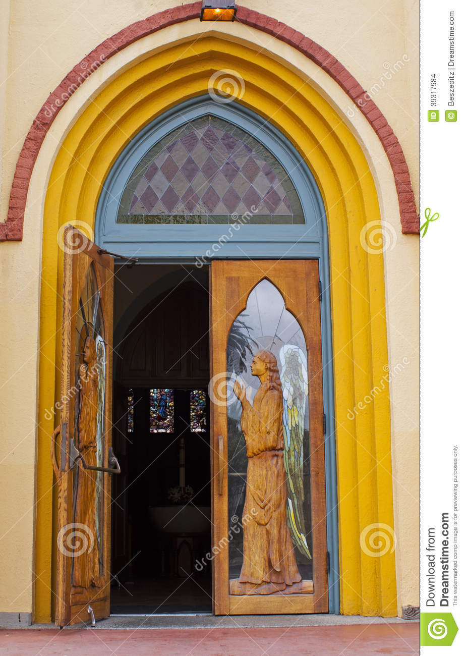 Church doors with stain glass, angels and wood. Door open looking ...