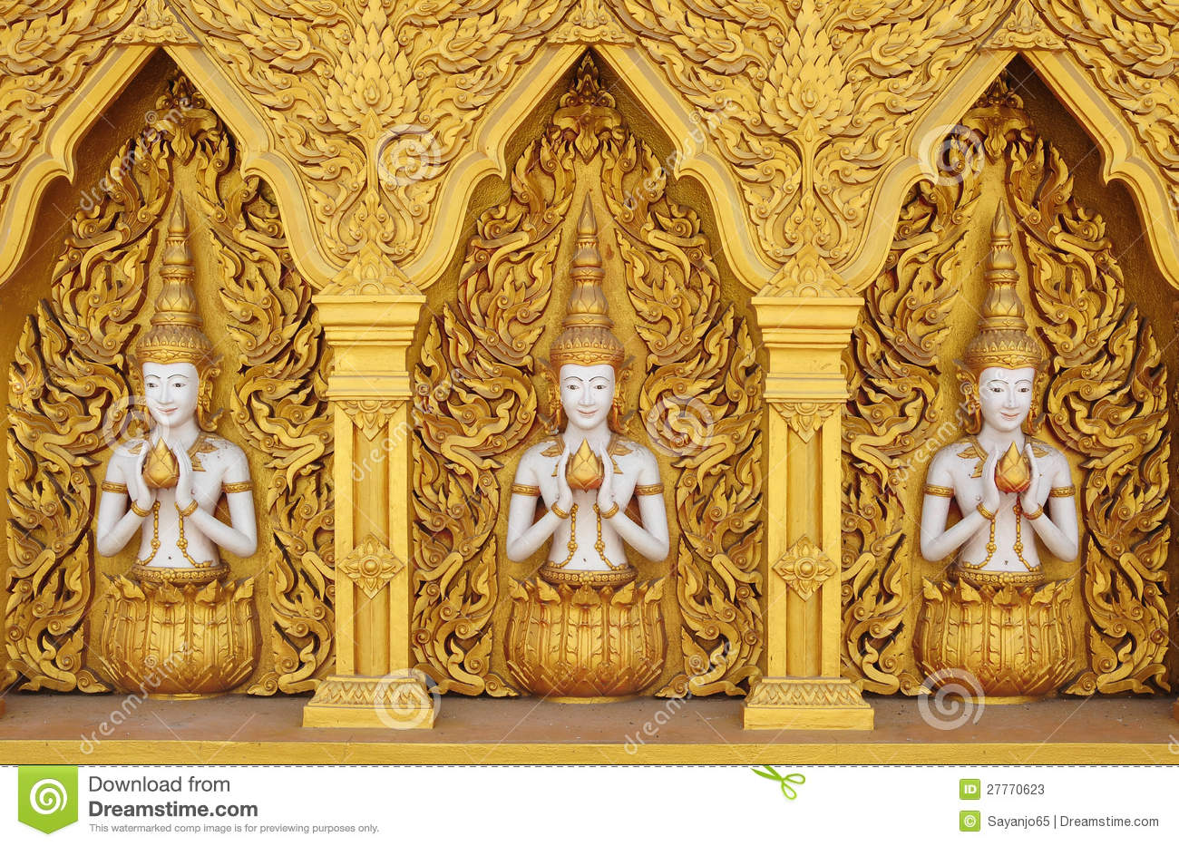 Angel Statues On The Walls. Golden Angel. Art Wall Stock Image ...