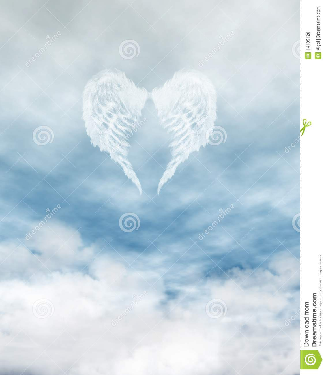 White feathered angel wings forming a heart shape on a background of ...