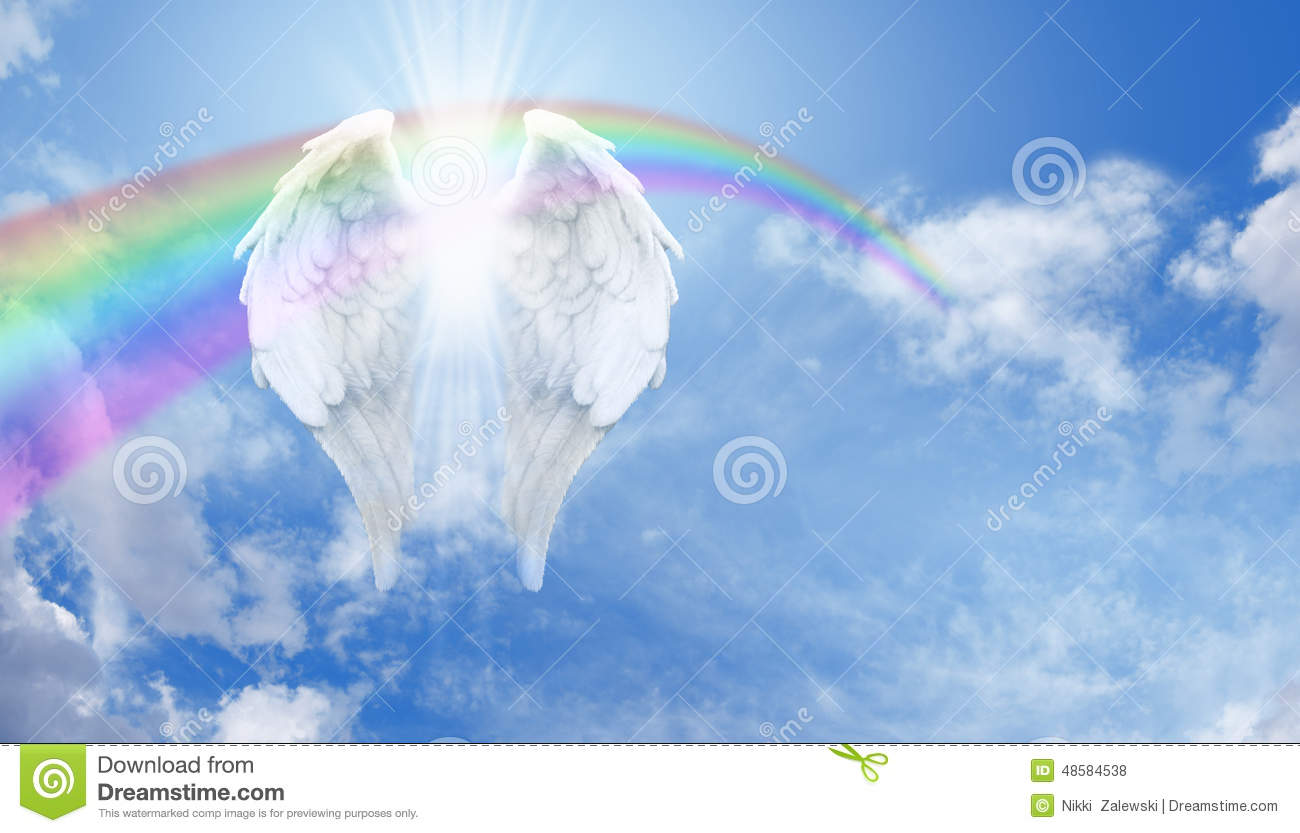 Angel Wings And Rainbow On Blue Sky Floating With An Arcing