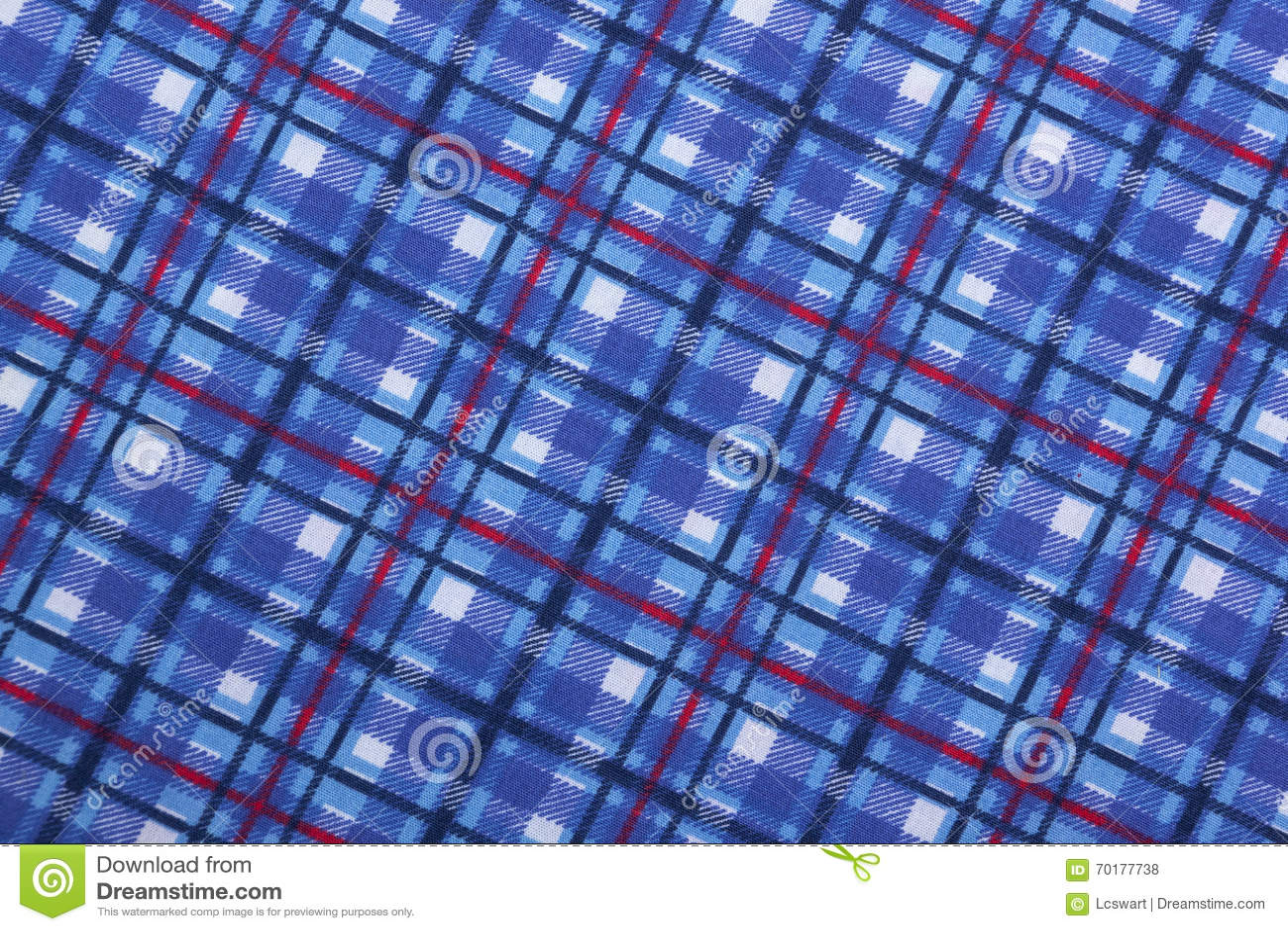 Angled взгляд голубых квадратных картин на ткани