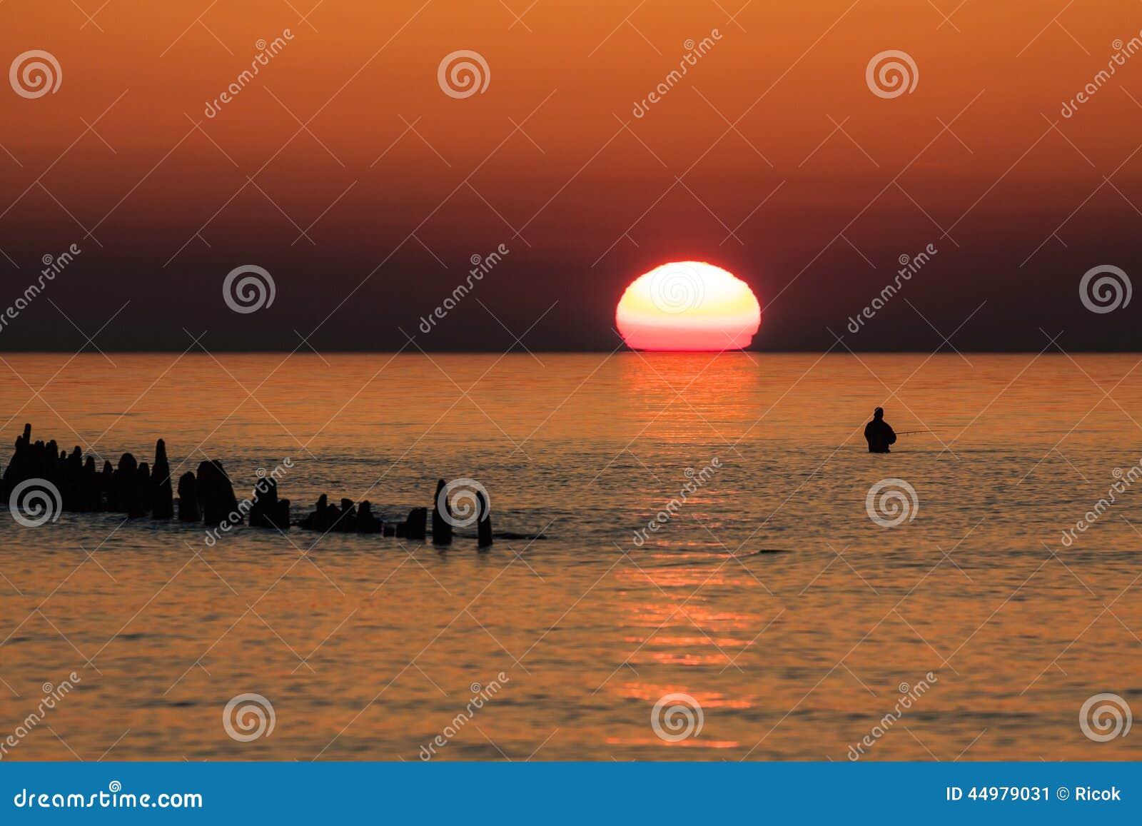 Angler on the Baltic Sea coast
