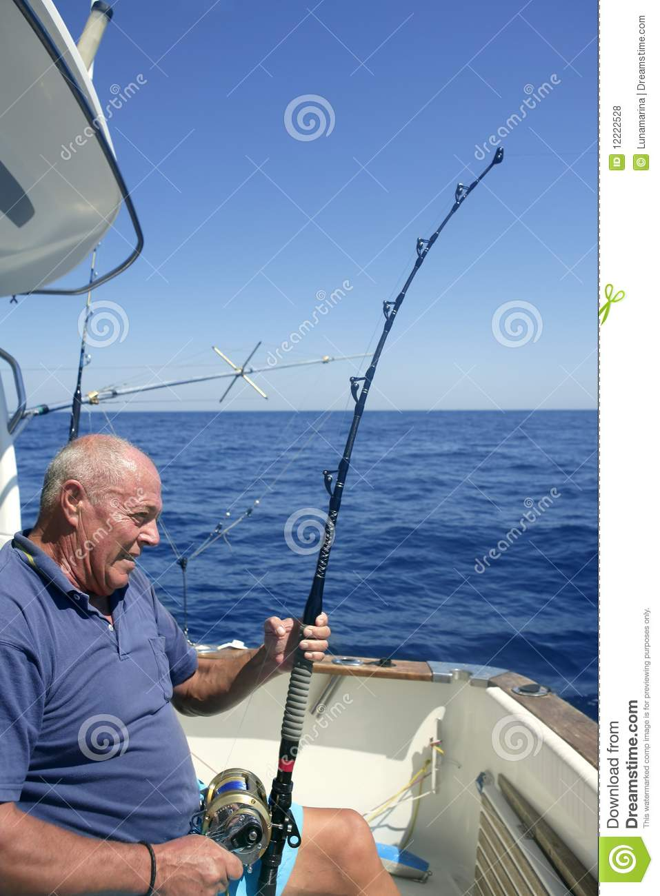 Angler fisherman fighting big fish rod and reel stock for Fishing boat games