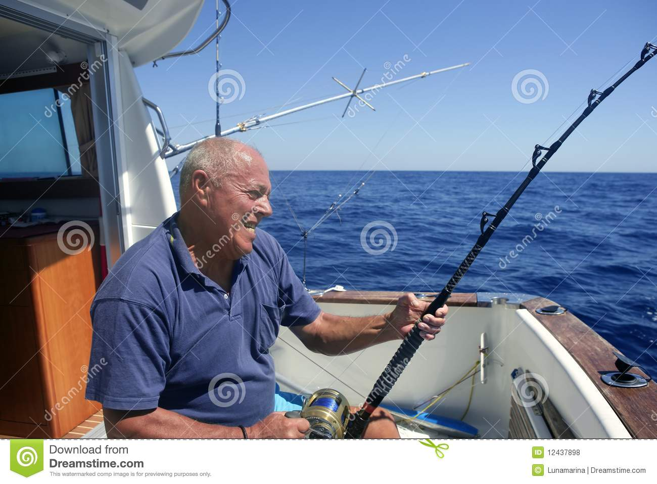 Angler fisherman fighting big fish rod and reel stock for Sport fishing games