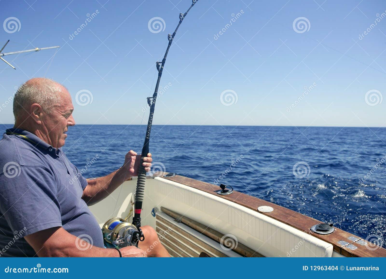 Angler senior big game sport fishing boat stock images for Big 5 fishing license
