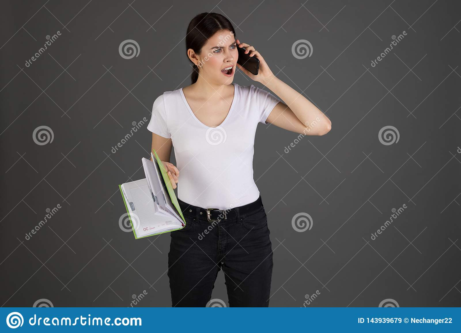 Angry agressive brunette businesswoman in white t-shirt