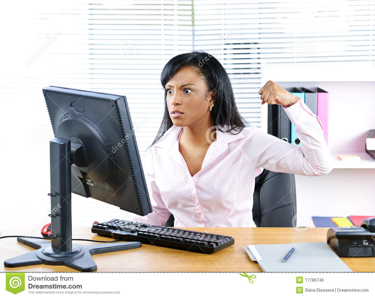 Angry Black Businesswoman At Desk Royalty Free Stock