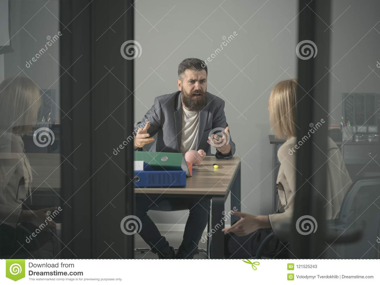 Angry boss shout at accountant in office. Bearded man and woman discuss company budget. Businessman blame financier in