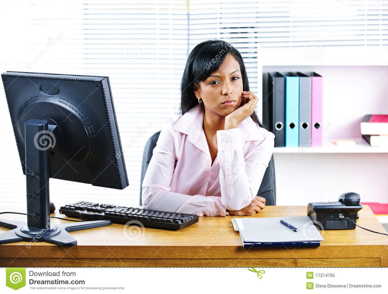 Angry Businesswoman At Desk Royalty Free Stock Photo - Image: 17214765