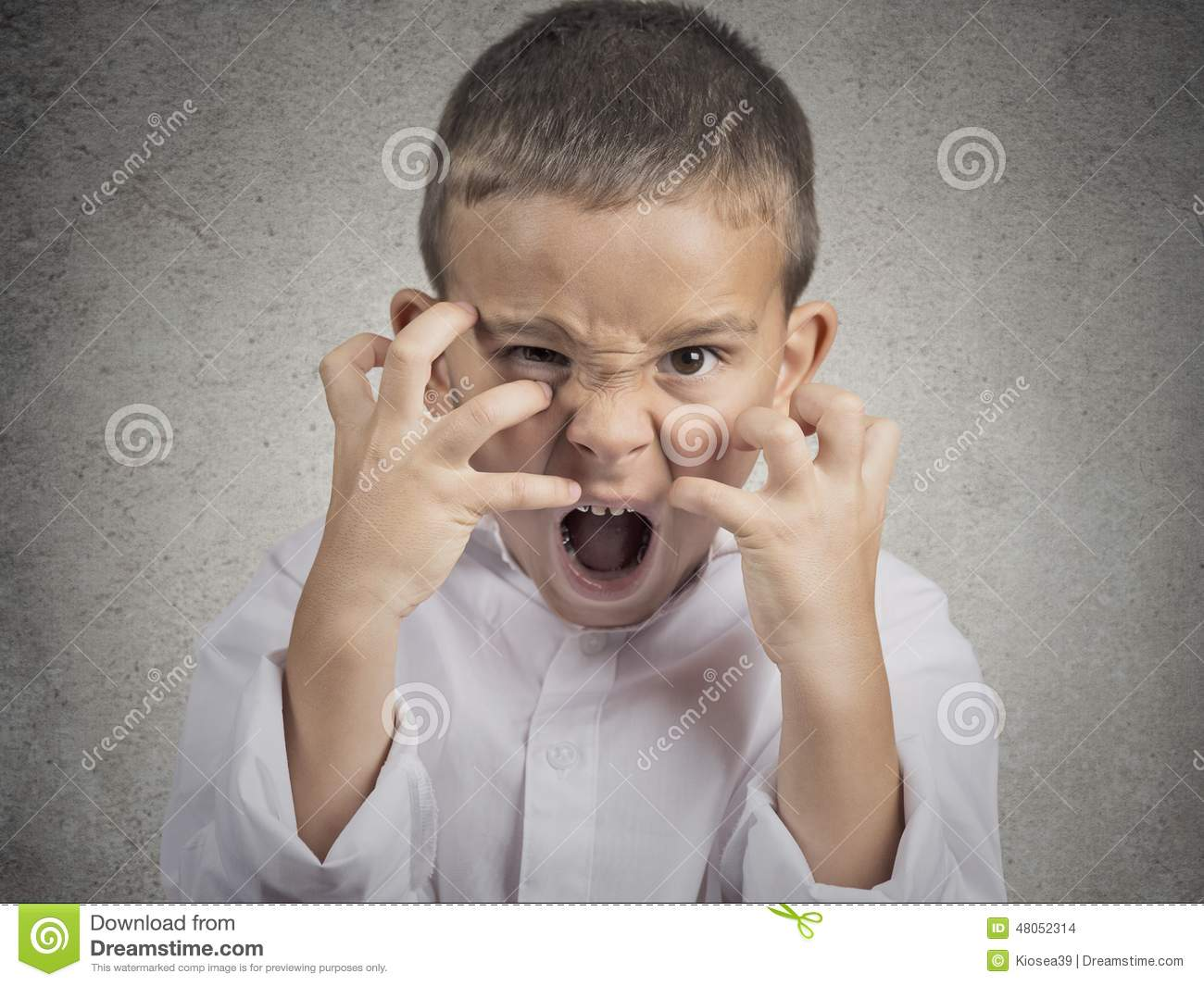 angry child  boy screaming hysterical stock photo