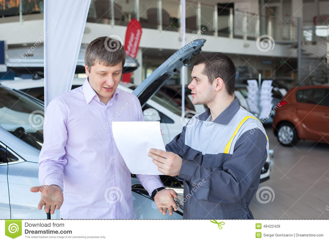 an angry customer talking to a mechanic in auto repair service stock photo image 48422428. Black Bedroom Furniture Sets. Home Design Ideas
