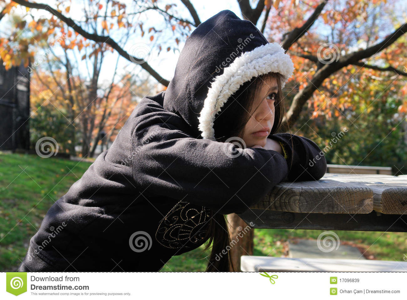 Angry and depressed girl sit in a park