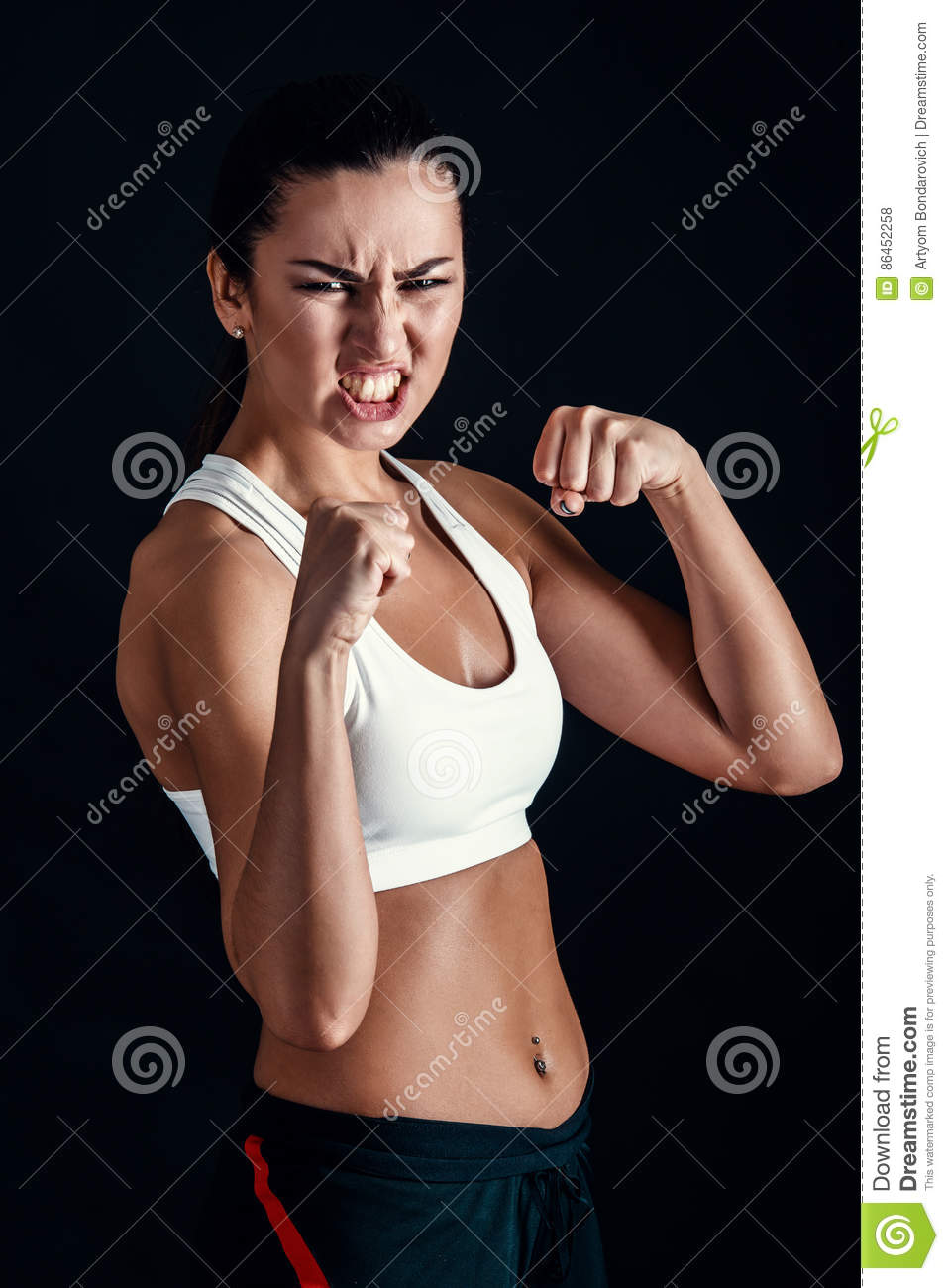 eb97db5ed5ae6 Angry Fitness Girl Ready For Fight On Black Background. Stock Photo ...