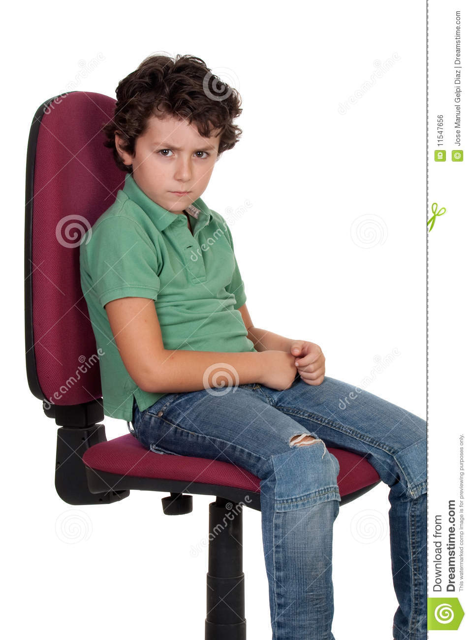 Angry Little Boy Sitting On Big Chair Stock Photo