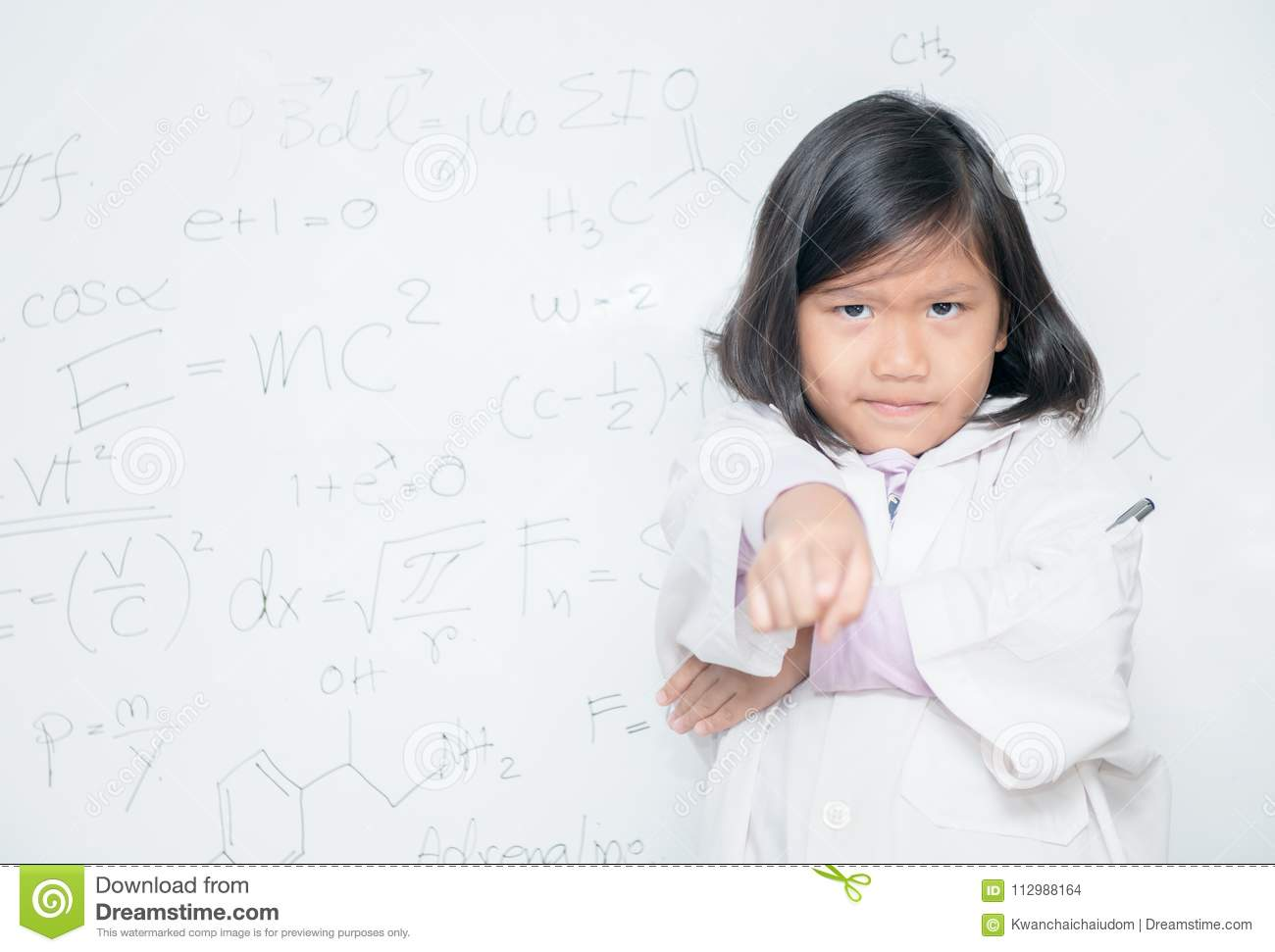 Angry little scientist pointing finger on white borad