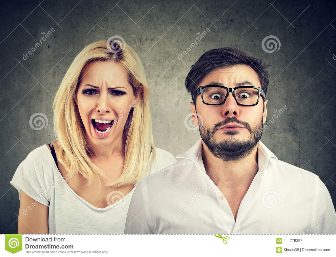 Angry mad woman screaming and fearful man