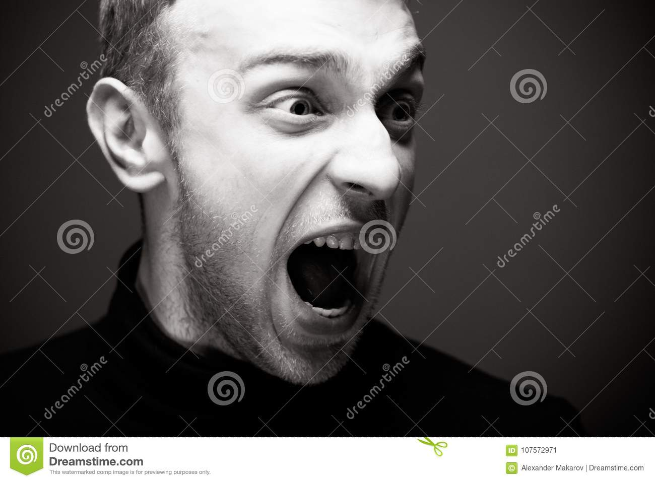 Angry Man Screaming A In Black Shirt Male Emotional Portrait