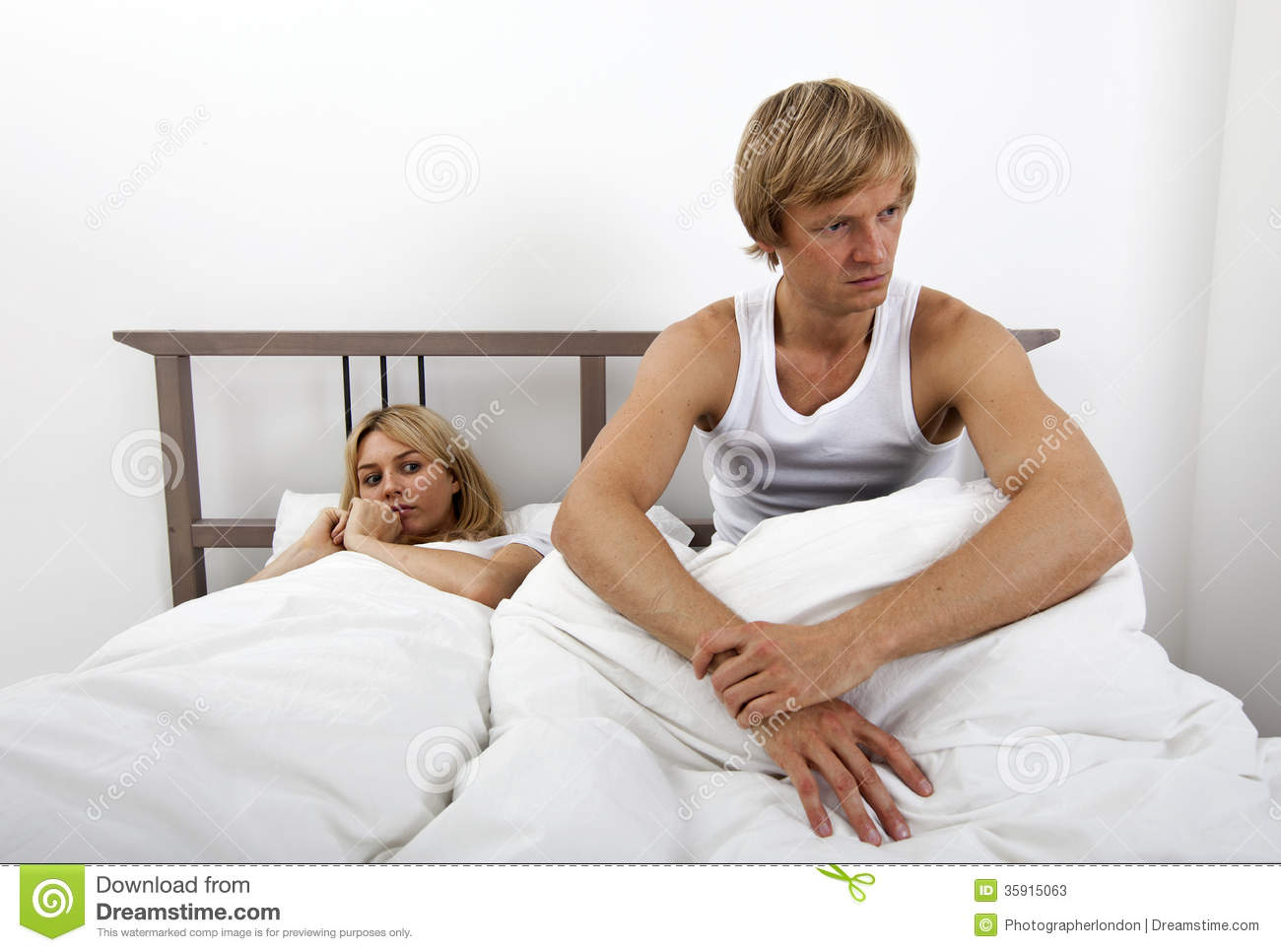 man on woman in bed pictures